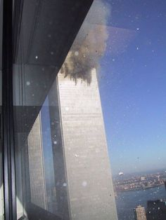 The View from a Nearby Window Near the Point of First Impact. At 8:46 AM EST, a passenger airliner, American Airlines Flight 11, struck the North Tower. The plane was scheduled to fly from Boston to Los Angeles, and was therefore chosen because it would be full of fuel for the cross country flight.