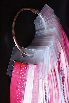 one of many ideas for ribbon storage on this page that are great in an organized craft room.