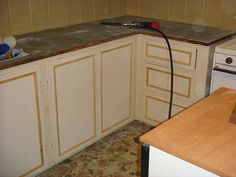 Complete refurbish of cabinets and counter with only trim and paint!