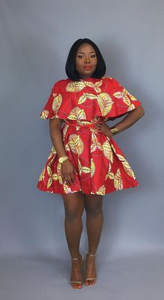 Honey,this loose fitting ,pullover red dress made from authentic African wax print is your perfect equivalent to the all time summer wrap dress;The any time,any place,any wear A line shift dress is very flattering to any body shape and will keep you looking sleek,modern and summer chic in any scenario.Youll also look smokin hot if styled with a matching belt to cinched in that waist to give you a perfect curve.A definite must have in your wardrobe this season ladies .  -Made from authentic…