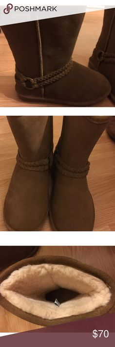 """NWOB Bearpaw Adele Chestnut Suede Boots Never worn! Brand new without box!   """"Bearpaw Adele Chestnut Tan Suede Boots. The Adele is accented with a simple but chic double-braided belt across the ankle attached to a silver metal charm. A sheepskin lining locks heat in, and a shearling footbed wicks away moisture for lasting dryness. A lightweight, durable TPR wedge outsole provides excellent traction on any surface in the Adele winter boot. FEATURES: Ultrasoft suede upper with braid"""" BearPaw…"""