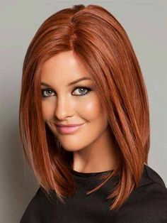Medium length straight bob with chestnut red hair color and low lights