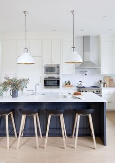 Herringbone backsplash with shaker cabinetry - super dreamy kitchen photo by Janis Nicolay