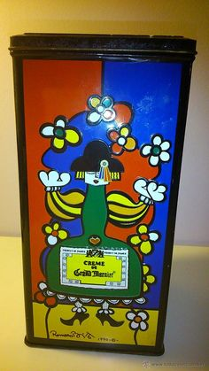 Preciosa caja de lata de creme de Grand Marnier, diseñada por Romero Brito.