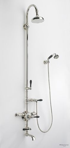 Exposed shower set with swan neck shower arm, bath filler and hand shower.