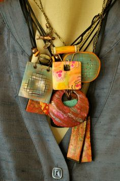 A gaggle of necklaces by Page's Creations, via Flickr