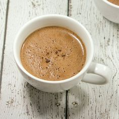 This Paleo & Whole30 Mocha Latte only uses 4 ingredients! Made with only coffee, coconut milk, cacao + vanilla beans, it's a guilt-free way to start the new year!