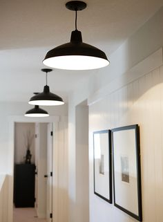 Love the clean simplicity ~ Warehouse/Barn  pendant lighting and set of thin black framed prints with large white matting ~ ♥
