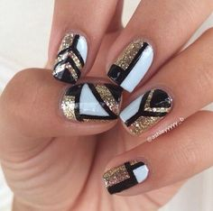 Black, gold, and white tribal nails