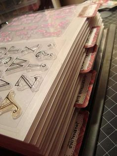Scraproom: My Stamp Binder!  She bought a box of transparencies & used those to put her stamps inside a ring-book she made.