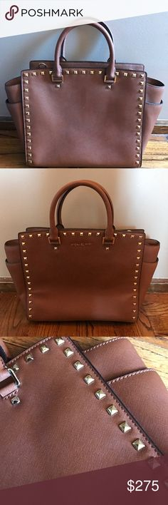 """🚨PRICE CHANGE 🚨 NWOT Michael Kors Stud Bag ✨Excellent Condition!!  ✨ Perfect color for fall and sized right for daily use, this sophisticated satchel can be adjusted and turned into a cross body!  Saffiano Leather Gold Toned Hardware Outside: 2 slip pockets, Zip Top closure  Double handles (5"""" drop length) and removable/adjustable long strap (22"""")  Feet on bottom of bag for protection against wear & tear  Inside: 4 slip pockets and 1 zip pocket Michael Kors Bags Satchels"""