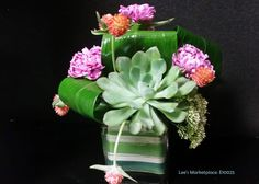 One of the beautiful custom arrangements designed by Lee's Corner Floral. Learn more or order yours today at leesmarketplacefloral.com
