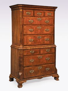 A fine quality George II period walnut veneered Tallboy, having moulded cornice enclosing secret drawer above various herringbone inlaid and crossbanded drawers. The piece, having concealed brushing slide to the waste moulding, crossbanded sides and fluted canted corners supported on ogee bracket feet. Circa: 1740 Ref: 5645