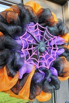 Miss Kopy Kat Halloween Deco Mesh Ruffle WreathRecently, I saw a deco mesh wreath that had the mesh attached in such a fun and fluffy way that I inspected it to see how it was Halloween 👻 Wreaths to Decorate ✂️ Your Door 🚪 . Halloween Mesh Wreaths, Holiday Wreaths, Halloween Crafts, Halloween Ideas, Holiday Ideas, Halloween Decorations, Halloween Camping, Halloween Witches, Halloween Spider
