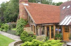 Oak frame barn room extension to cottage, with beautiful clay roof tiles. By Roderick James Architects. Oak Framed Extensions, House Extensions, Beautiful Buildings, Beautiful Homes, Extension Designs, Extension Ideas, Oak Framed Buildings, Oak Frame House, Timber Architecture