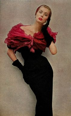 1952 suzy parker in givenchy's deep red roses. a bolero of a thousand chiffon petals piled above a strip of black wool. darker than the roses, and velvet
