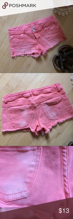 Faded coral cutoff jean shorts Super cute AND comfy cutoff jean shorts faded coral color. Small mark on seat that's hardly noticeable. Lots of life left. refuge Shorts Jean Shorts