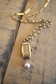 Items similar to Redesigned ART DECO necklace / vintage watch necklace / faux pearl / Upcycled necklace on Etsy Vintage Jewelry Crafts, Recycled Jewelry, Old Jewelry, Jewelry Art, Beaded Jewelry, Jewelery, Jewelry Accessories, Handmade Jewelry, Jewelry Design