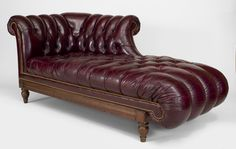 English Victorian Maroon Leather Recamier With Tufted Seat And Roll Arms And Back With Nail Head Trim On A Wood Frame And Legs   c.19th-20th Century