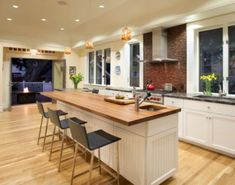 Kitchen Island Seating modern-kitchen island with seating on the end and corner sink