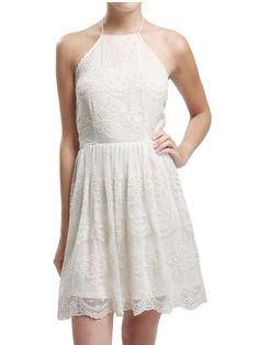 Feelin' cute and country in this little lace dress with a beautiful halter neck
