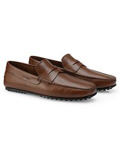 Clean lines are a sophisticated choice in these urban penny loafers, while the rubber sole with iconic pebbles guarantees versatility whether rain or shine.  Hand-crafted details and high quality brushed leather are distinguished touches.  http://store.tods.com/Tods/US/categories/Shop-Men/Shoes/Loafers/Leather-Penny-Loafers/p/XXM0LR00011D90S801