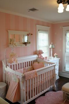 LOVE the different paint designs on each wall! Stripes here... Polka dots there... Every little Princess' dream!!