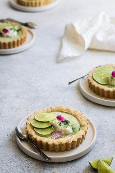 These mini vegan key lime pies make the absolute best vegan key lime pie recipe! This recipe is easy to make and requires no dairy. These mini pies are also gluten-free, grain-free and refined-sugar free for a healthy dessert! #keylime #pie #keylimepie #vegan #vegandessert #vegankeylimepie #tarts #minitart #coconut #veganrecipes #veganfood