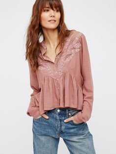 Tulips Embroidered Buttondown | Semi-sheer buttondown that is cropped to the natural waist and features beautiful embroidery and dotted mesh detailing along the bust. Dolman style long sleeves with a high low hem and an oversized silhouette.