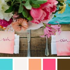 Aqua, ivory, peach, coral and brown. Looks like aqua, ivory, orange, pink and brown...