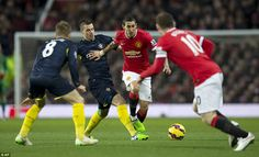 Angel di Maria (second right) is dispossessed by Southampton midfielder Morgan Schneiderli...