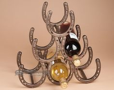 Western Iron Art Wine Rack -Horseshoes, $39.95 (http://www.missiondelrey.com/western-iron-art-wine-rack-horseshoes-ia21/)