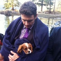 James Franco with a cavalier king charles spaniel puppy!! I don't think it gets much cuter than that.
