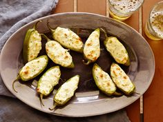 Recipe of the Day: Rachael's Roasted Jalapeño Poppers Nothing says game day like snacking on a truckload of jalapeño poppers. Remake the bar staple by stuffing peppers with smoked pepper cheese, feta and cream cheese and cooking them in the oven instead of frying.