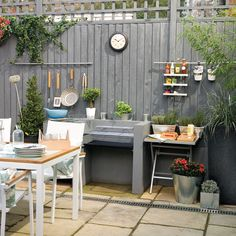 Garden fence painted grey with cooking station