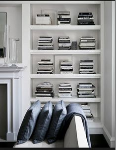 I tried to do something similar with a whole bookshelf only containing white books. white books are really hard to find! Design Perfectionist White, black and grey - Todd Waterbury's home Decoration Inspiration, Interior Inspiration, Interior Ideas, Room Inspiration, Interior Decorating, Style At Home, Home Interior, Interior Styling, Kitchen Interior