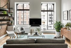 Instead, elegant and low-maintenance pieces were brought into this industrial-style space to create the ultimate bachelor apartment—except that by the end of the redesign, Green was a bachelor no more.