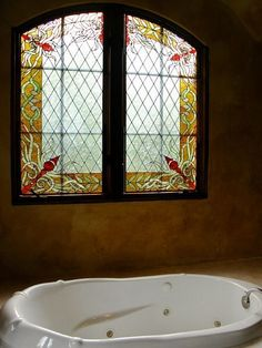 Stained glass window by the tub
