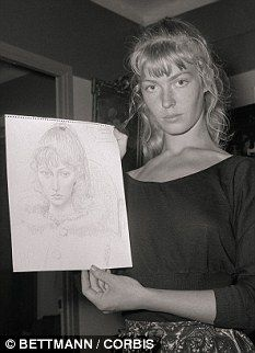 A 19-year-old Lydia Corbett (Sylvette David) poses with one of Picasso's sketches of her in 1954.