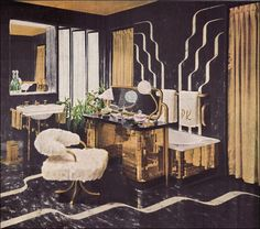 American Style Through the Decades: The Forties   From Armstrong, an exuberantly decadent bathroom of gold tile and black linoleum. Note how the built-in dressing table is used as a screen for the tub.