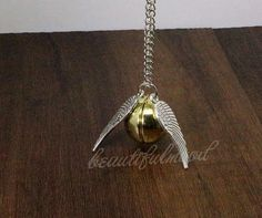Harry Potter jewelry Golden Snitch locket by beautifulmood on Etsy