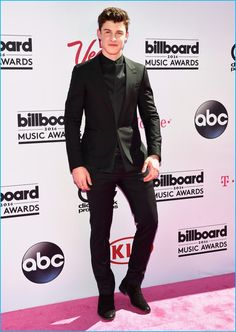 Posing for pictures at the 2016 Billboard Music Awards, Shawn Mendes dons a black on black look from Balenciaga.