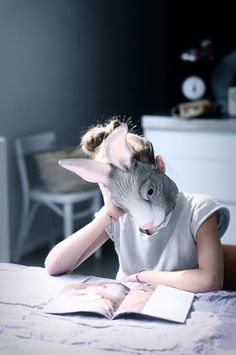 Alice's parents forced her to wear the rabbit mask and stay inside all day. She did not know why, but she found herself fascinated with daydreaming about another life. Then, one day, she saw a white rabbit and, mistaking it for her own kind, she followed it outside, against her parent's rules, and discovered a strange new world...