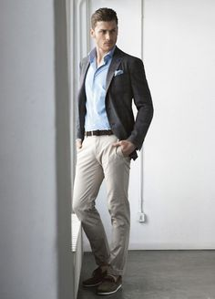 Wear a light blue dress shirt and beige chinos if you're going for a neat, stylish look. Channel your inner Ryan Gosling and opt for charcoal suede tassel loafers to class up your look.  Shop this look for $367:  http://lookastic.com/men/looks/pocket-square-and-dress-shirt-and-blazer-and-belt-and-chinos-and-tassel-loafers/3792  — Light Blue Pocket Square  — Light Blue Dress Shirt  — Charcoal Blazer  — Black Leather Belt  — Beige Chinos  — Charcoal Suede Tassel Loafers