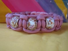 Paracord bracelets with beads. $13.00, via Etsy.