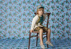 Junior Look 2 from Gucci's new Children's Cruise Collection. Featuring a tiger intarsia sweater inspired by the men's cruise 2016 ready to wear collection, tiger print shorts, GG Supreme cat cap, and paisley print espadrilles.