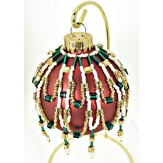 Green, Gold, and Pearl Beaded Christmas Ornament With Red Christmas... ($18) ❤ liked on Polyvore featuring home, home decor and holiday decorations