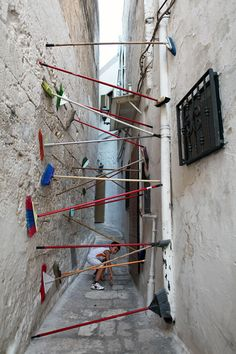 "Brakay is the name of the collaboration between Brad Downey & Akay during this years Fame Festival in Grottagli, Italy. This video called ""tipping point 2″ and the found objects in those narrow little alleys, caught my attention."