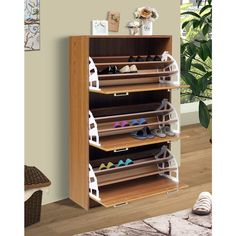 Standing just over four feet tall, the Concepts Deluxe Triple Shoe Cabinet – Oak is an ideal way to finally get a handle on those shoes. Shoe Dresser, Diy Shoe Rack, Shoe Racks, Diy Shoe Organizer, Shoe Storage Cabinet, Garage Shoe Storage, Shoe Storage Display, Shoe Storage Hacks, Shoe Shelves