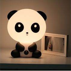 """This is for you Lisa! """"Panda lamp"""" Just press its belly button and this charming panda lamp will lighten up the room with a soft glow and put a smile on Lisa's face!"""
